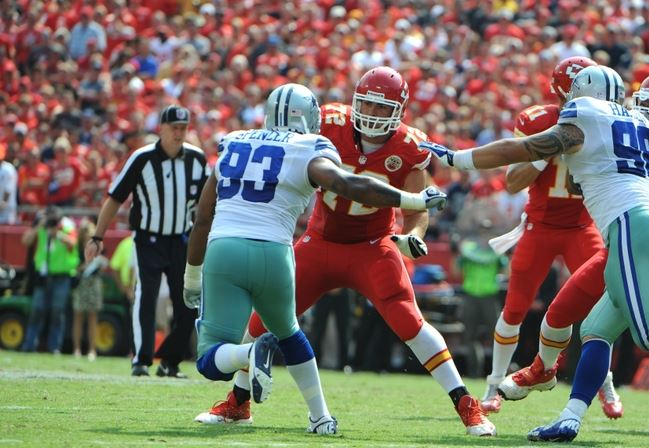 Sep 15, 2013; Kansas City, MO, USA; Kansas City Chiefs offensive tackle Eric Fisher (72) blocks against Dallas Cowboys defensive end Anthony Spencer (93) in the second half at Arrowhead Stadium. Kansas City won the game 17-16. Mandatory Credit: John Rieger-USA TODAY Sports